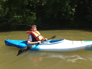 Our nephew Isaac kayaking along the Harpeth River.