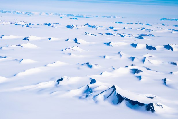 Antarctica mountain ranges stretching towards the horizon.