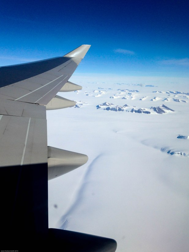 Antarctic mountains peering through the dense snow and ice.