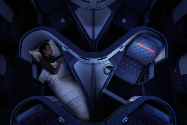 A man sleeping in Delta One on an Airbus 330-300 (333). - These images are protected by copyright. Delta has acquired permission from the copyright owner to the use the images for specified purposes and in some cases for a limited time. If you have been authorized by Delta to do so, you may use these images to promote Delta, but only as part of Delta-approved marketing and advertising. Further distribution (including proving these images to third parties), reproduction, display, or other use is strictly prohibited.